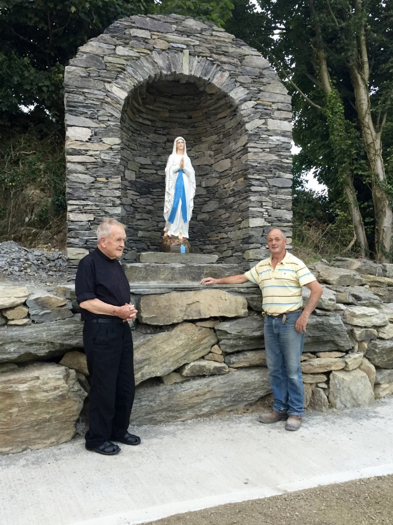 Fr Pat Walsh PE with Micheál Dullea, builder, at the new Grotto in Ahiohill.